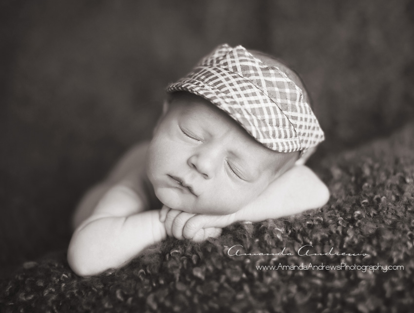 sleeping newborn with visor on meridian photographer